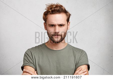 Gloomy Bearded Guy Frowns Face, Being Dissatisfied With Results Of Competition, Keeps Hands Crossed,