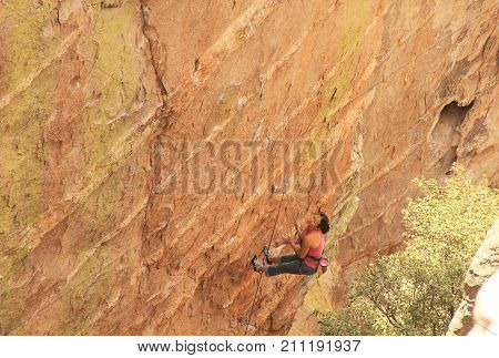 TUCSON, ARIZONA, USA --April 19, 2014:  Woman with a look of anguish is resting from lead rope climbing a hoodoo near Windy Point on Mount Lemmon in Tucson, Arizona, USA in the Santa Catalina Mountains located in the Coronado National Forest with copy spa