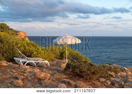 Sun Loungers And Umbrellas On The Sea