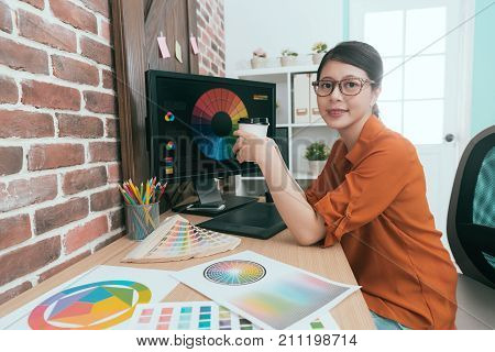 Female Graphic Designer Holding Hot Coffee Cup