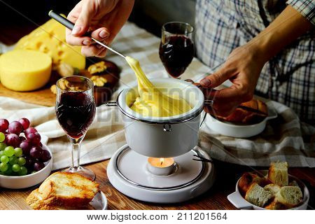 fondue with croutons ,red wine and grapes