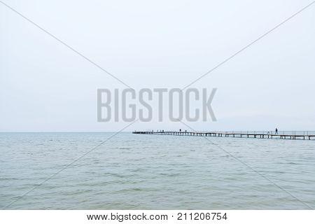Evening pebble transparent sea. Black sea spring limpid water