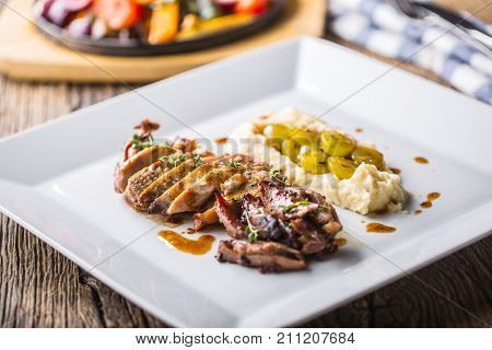 Pheasant Breast And Thigh Roasted With Mashed Potatoes And Grill Vegetable. Delicious Portion Pheasa