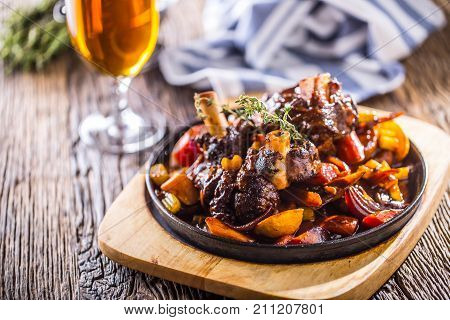 Lamb Shank.confit Lamb Shank With Potatoes Vegetable And Draft Beer In Pub Hotel Or Restaurant