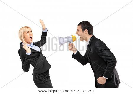 An angry businessman yelling via megaphone to a scared businesswoman isolated on white background