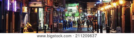 DUBLIN IRELAND - SEPTEMBER 7 2014: Nightlife at popular historical part of the city - Temple Bar quarter in Dublin Ireland. The area is the location of many bars pubs and restaurants