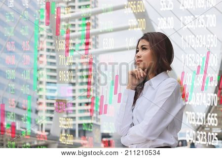 Double exposure of leadership young Asian business woman looking at far away with candlestick chart patterns uptrend on background. Stock exchange concept