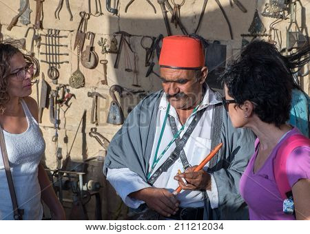 Arabian Traditional Dressed Seller, Sell Old Rusty Iron Tools
