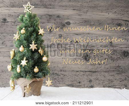 German Text Wir Wuenschen Ihnen Frohe Weihnachten Und ein Gutes Neues Jahr Means We Wish You A Merry Christmas And A Happy New Year. Tree With Gray Vintage Background. Rustic Wooden Style With Snow