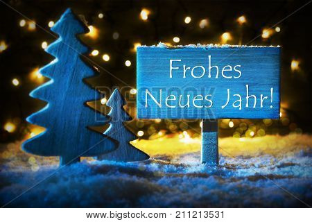 Sign With German Text Frohes Neues Jahr Means Happy New Year. Blue Christmas Tree With Snow And Magic Glowing Lights In Backround. Card For Seasons Greetings.