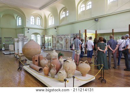 Tourists Visiting The Exhibition In The Museum Hall Of The Byzantine Exhibition In Chersonesus Tavri