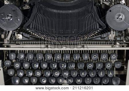 Old vintage typewriter close up photo background