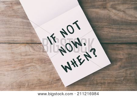 Inspirational Quotes - If Not Now, When? On Notepad On Top Of Wooden Table.