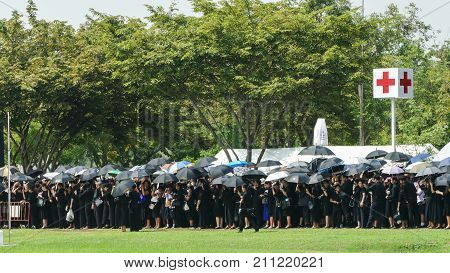 NAKHON PATHOM THAILAND - OCTOBER 26 : People stand on the queue to join The Royal Cremation for His Majesty the late King Bhumibol Adulyadej at Nakhon PathomThailand on October 26 2017