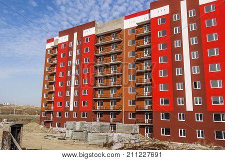 Apartment building under construction. Construction site. Apartment building brightly painted