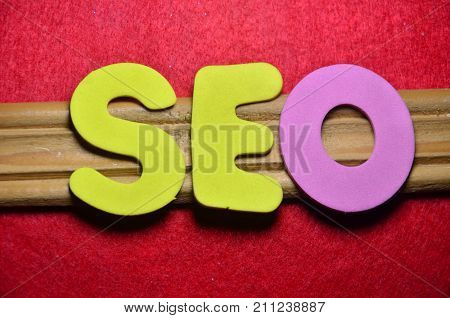 the word seo on a abstract red background