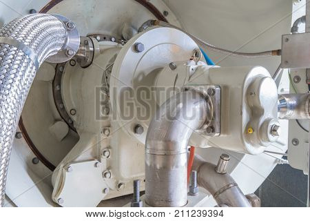 Gear pump and bearing housing at air intake of power turbine engine.