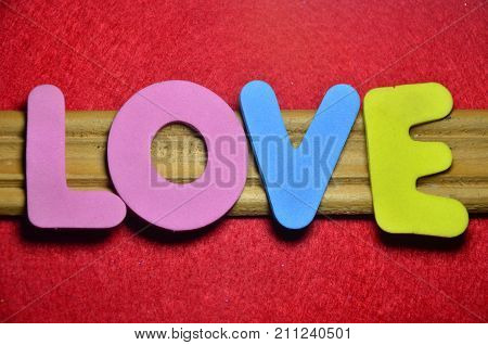 the word love on a  abstract red background