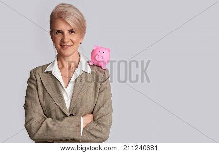 Old Business Woman With Piggy Bank. Isolated