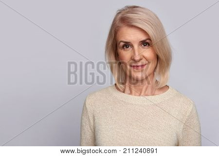 Old Woman Isolated On Grey
