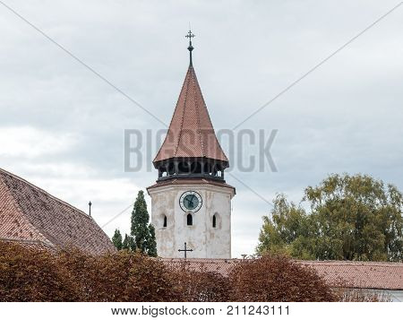 Watchtower with the clock of the Fortified Church Prejmer in Prejmer city in Romania
