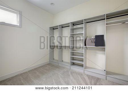 Empty Walk-in Closet With Open Shelves