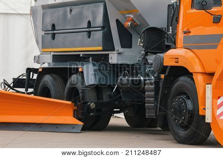 Orange scraper - part of truck constriction vehicle, close up