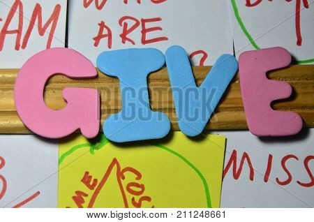 theword give on a abstract colorful background