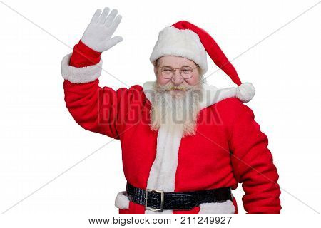 Santa Claus smiling and waving. Happy Santa Claus with real beard waving with hand on white background. Greeting of santa Claus, sstudio shot.