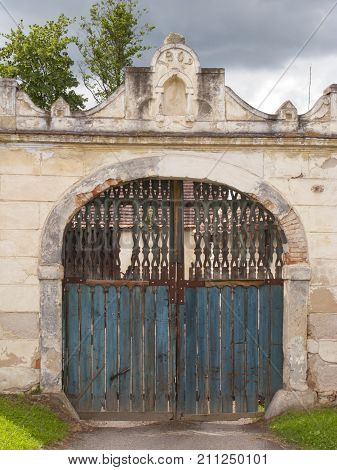 Old metal and wooden gate dated 1902