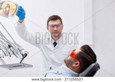 Shot of a professional mature male dentist working with his male client preparing for dental examination copyspace profession occupation communication experience medicine healthcare concept.