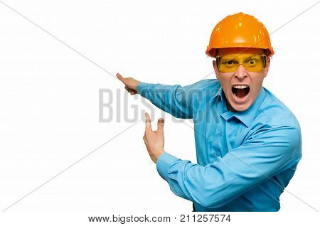 Wicked worker engineer in helmet and glasses swears and scream at someone and shows on something behind him. Poor work performance.
