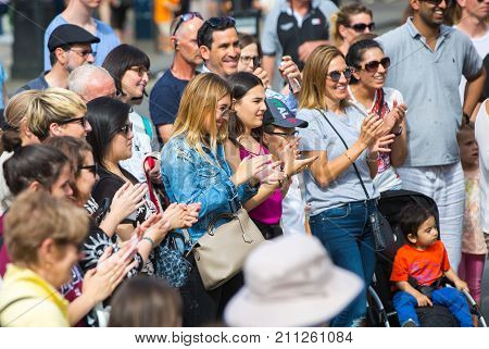 London, UK - August 24, 2017: Crowd of people watching the street performance in the Regent street. Happy smiling people