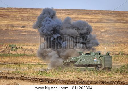 NOVOCHERKASSK RUSSIA 26 AUGUST 2017: Military self-propelled radio-controlled robot sapper clears the minefield