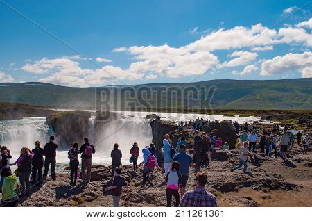 Tourists Near Godafoss Waterfall In Iceland