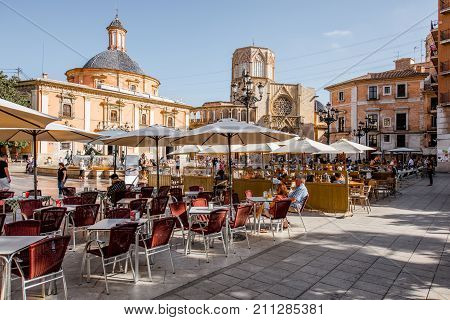 VALENCIA, SPAIN - August 18, 2017: View on the Virgen square with cafe terrace and cathedral on the background in Valencia city, Spain