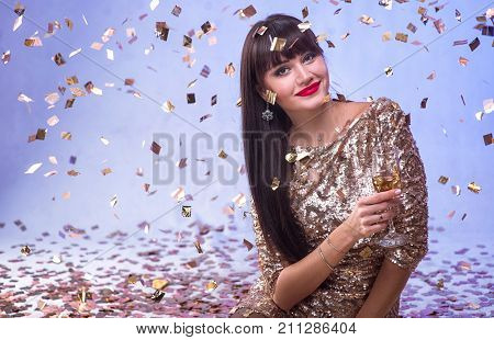 Beautiful Happy Woman With Glass Of Champagne At Celebration Party With Confetti Falling Everywhere