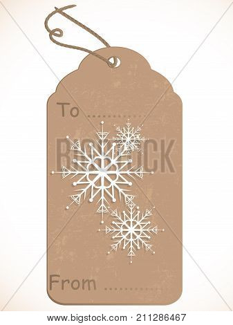 Brown retro gift tag with snowflakes - vector