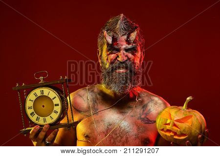 Halloween Man Demon Hold Pumpkin And Clock