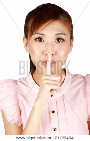 Young Asian Business Woman With Finger On Lips.