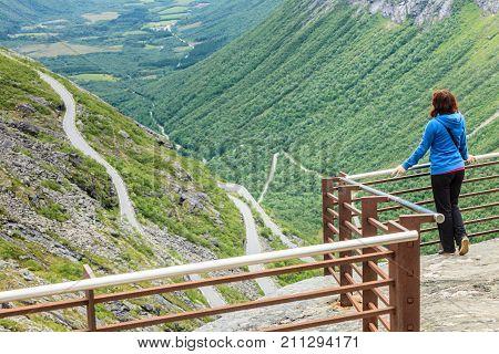 Tourist Woman On Trollstigen Viewpoint In Norway