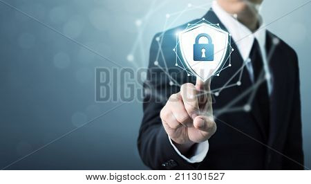 Businessman touching shield protect icon Concept cyber security safe your data