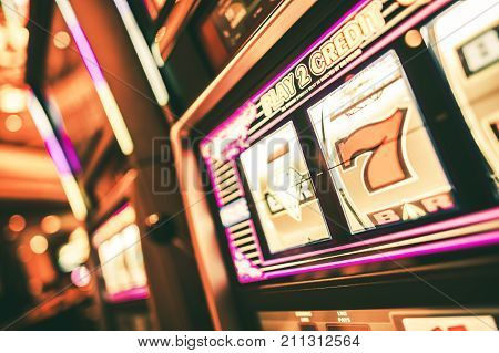 Lucky Slot Machine in the Casino. One Handed Bandit Closeup. Gambling Theme.