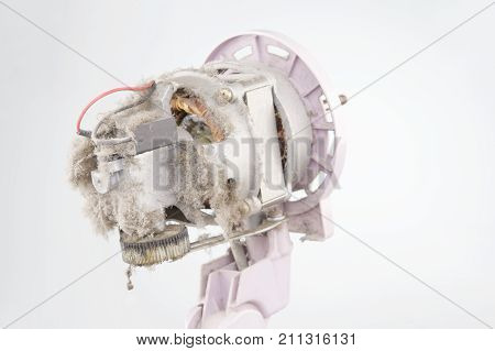 Close Up Motor Of Electric Fan With Dust White Background