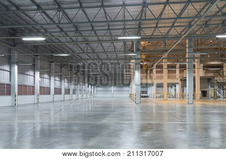Empty factory building or warehouse building with concrete floor for industry background.