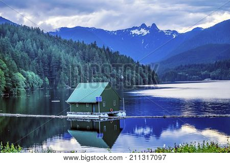 Capilano Reservoir Lake Green Building Dam Snowy Two Lions Snow Mountains Vancouver British Columbia Pacific Northwest