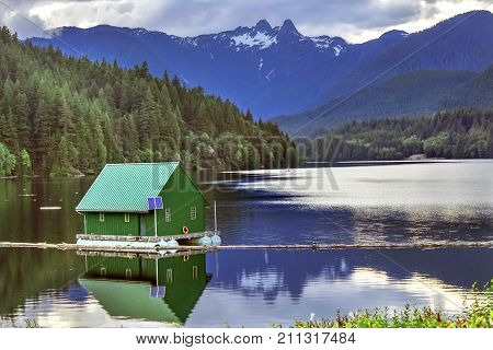 Capilano Reservoir Lake Green Building Dam Snowy Two Lions Snow Mountains Vancouver British Columbia Canada Pacific Northwest