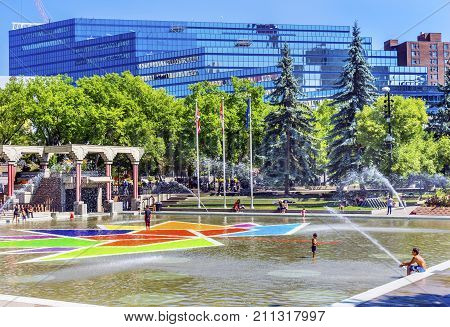 CALGARY, ALBERTA, CANADA - AUGUST 9, 2017 Children Playing Olympic Plaza Fountains Summer Downtown Calgary Alberta Canada. Olympic Plaza was created in 1988 for Olympic Winter Games.