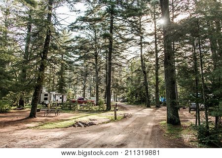 Lake of two rivers Campground Algonquin National Park a Beautiful natural forest landscape Canada Parked RV camper car
