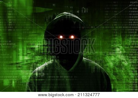 Unknown hacker standing on binary code background